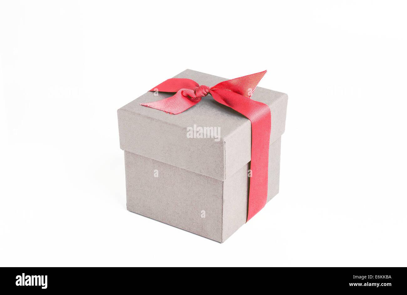 Geschenk-Box mit rotem Band Stockbild