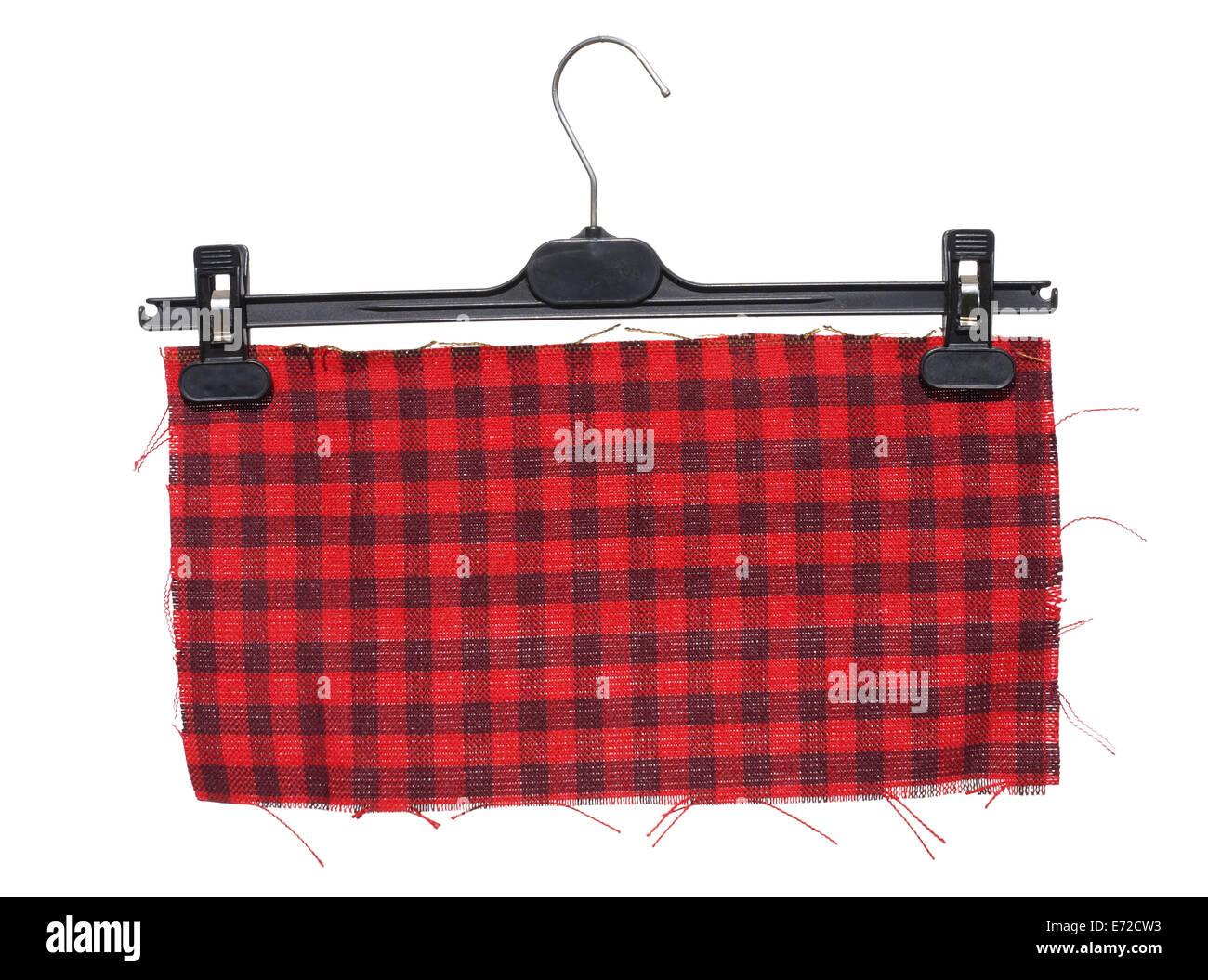 Kunststoff Kleiderbugel Mit Hangenden Darauf Ein Stuck Rot Karierten