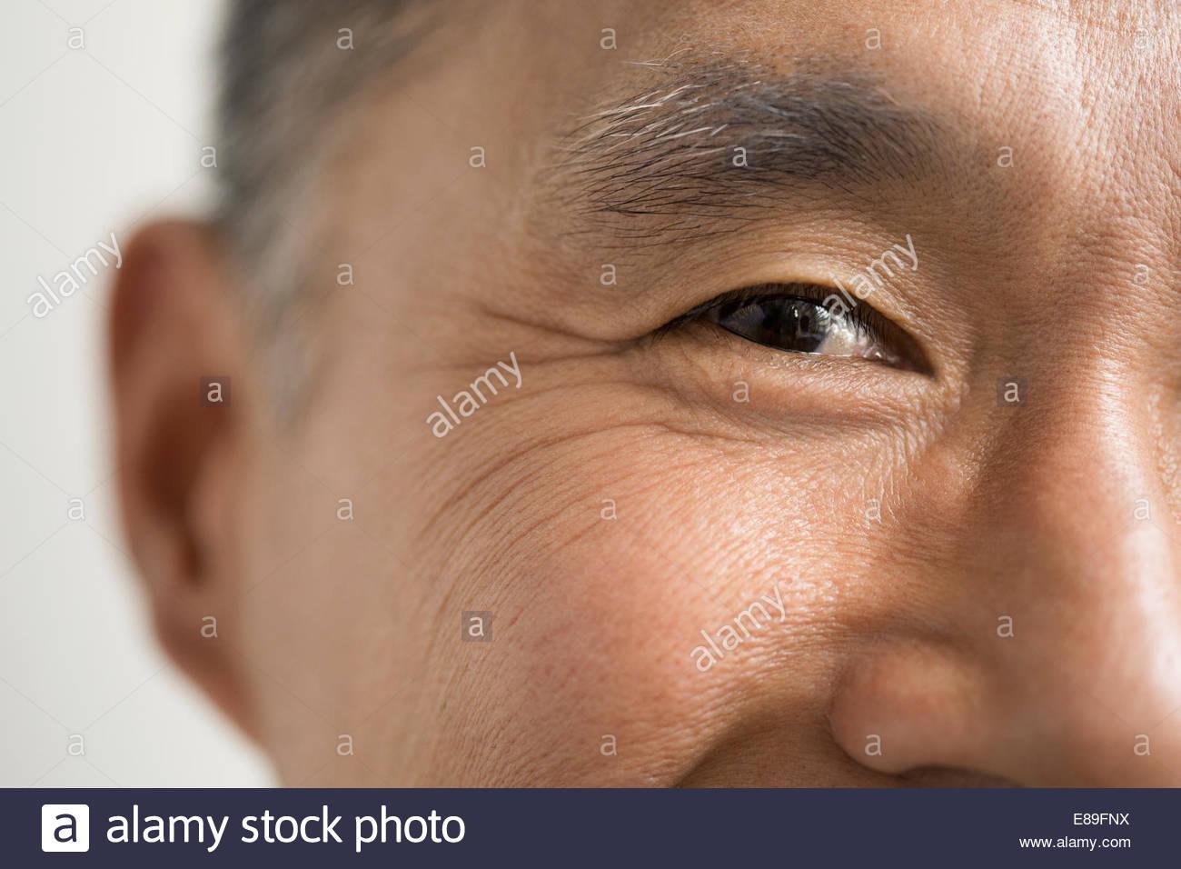 Nahaufnahme von Augen lächelnder Mann Stockbild