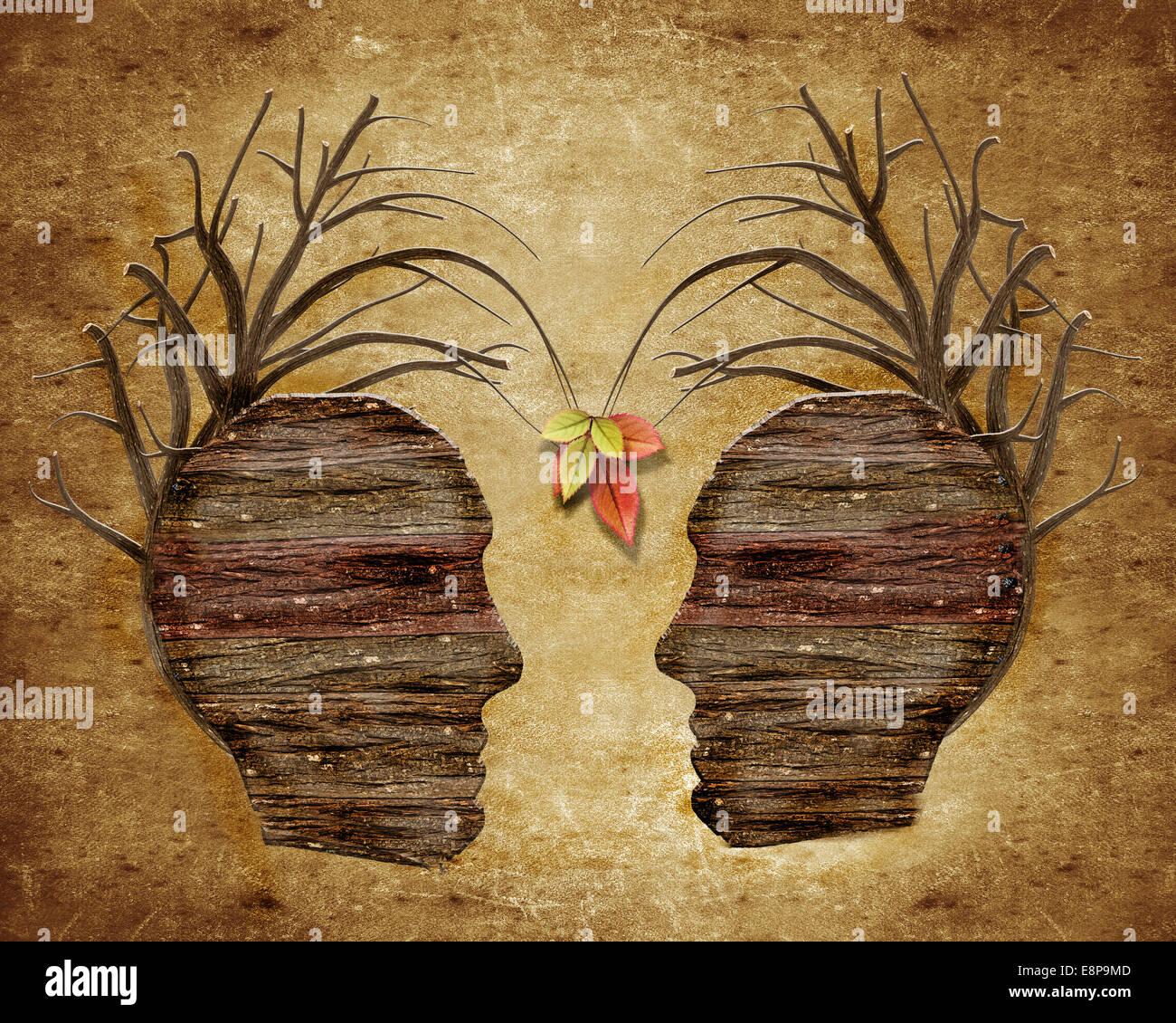 Zwei Holz menschlichen Kopf und Blätter Stockfoto