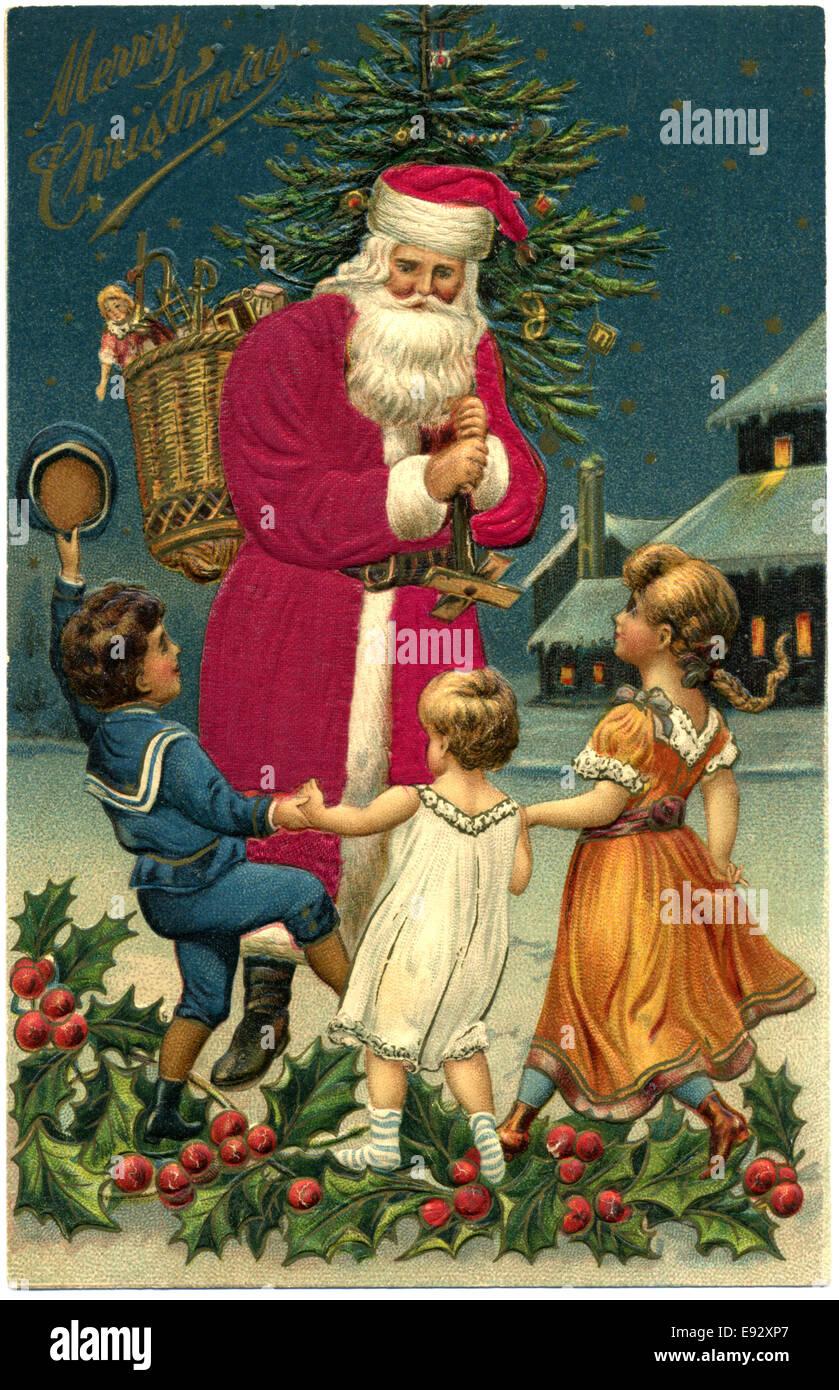"""Santa Claus mit drei Kindern, """"Frohe Weihnachten"""", Postkarte Stockbild"""