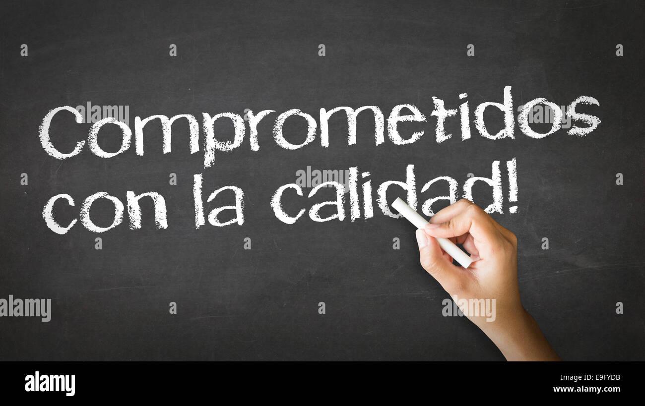 Qualität (auf Spanisch) verpflichtet Stockbild