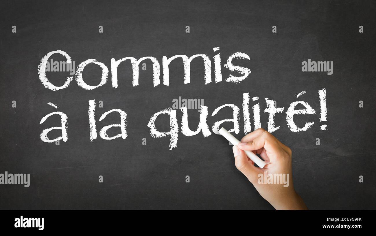 Qualität (auf Französisch) verpflichtet Stockbild