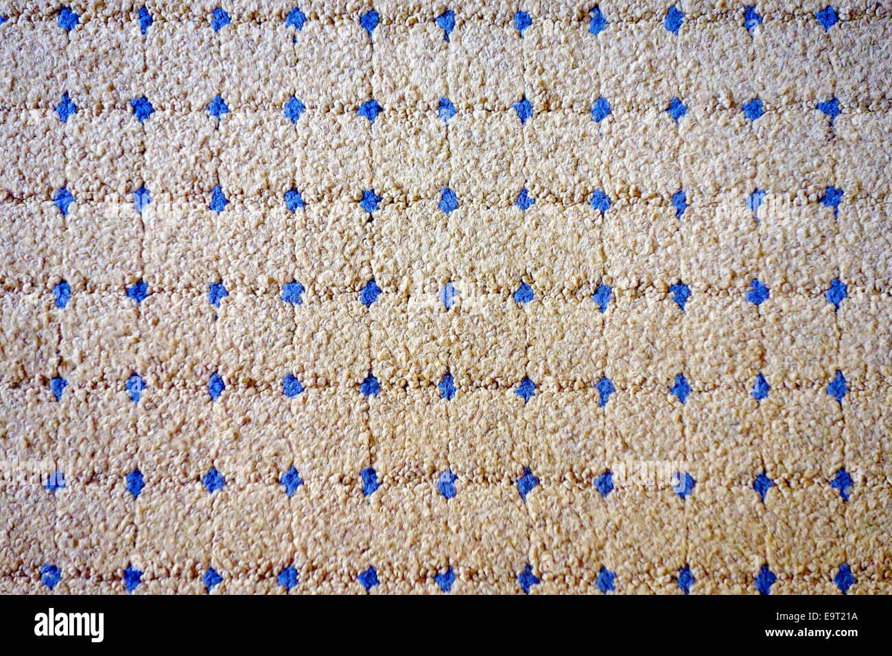 Gemusterten Design eines Teppichs Stockbild