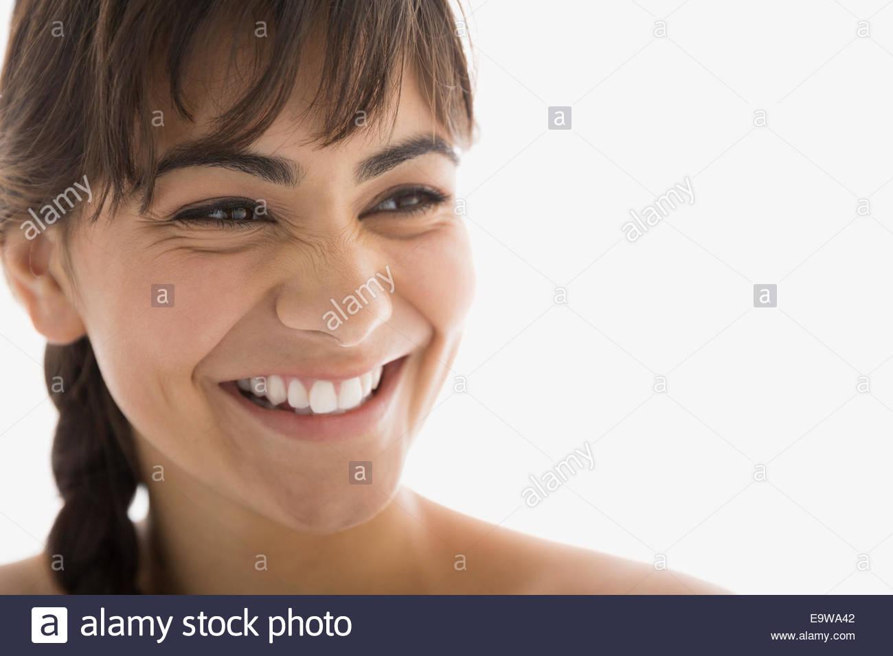 Nahaufnahme von begeisterten Brünette Frau wegschauen Stockbild