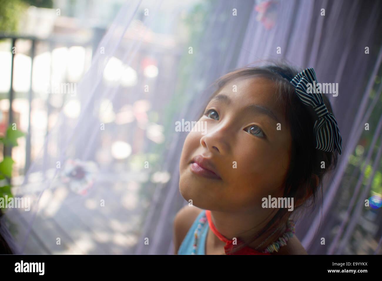 Porträt der jungen Asiatin, Kopf und Schultern, close-up Stockbild