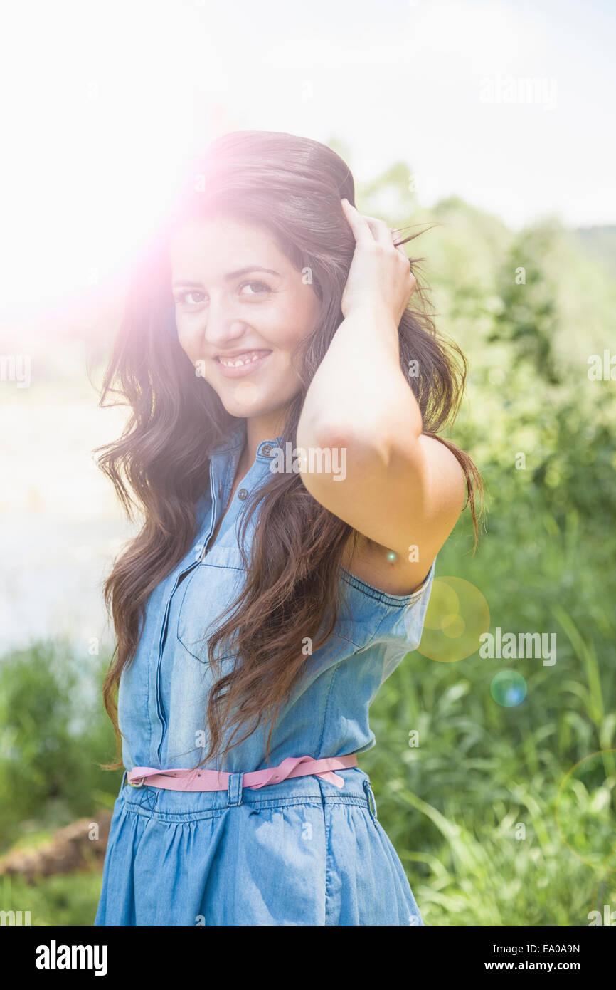Junge Frau posiert Stockbild