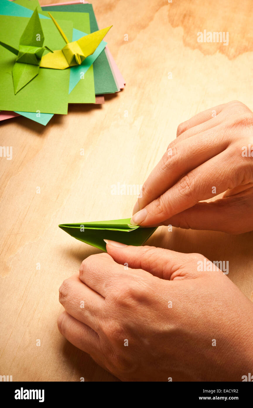Frau Papier für Origami Falten Stockbild