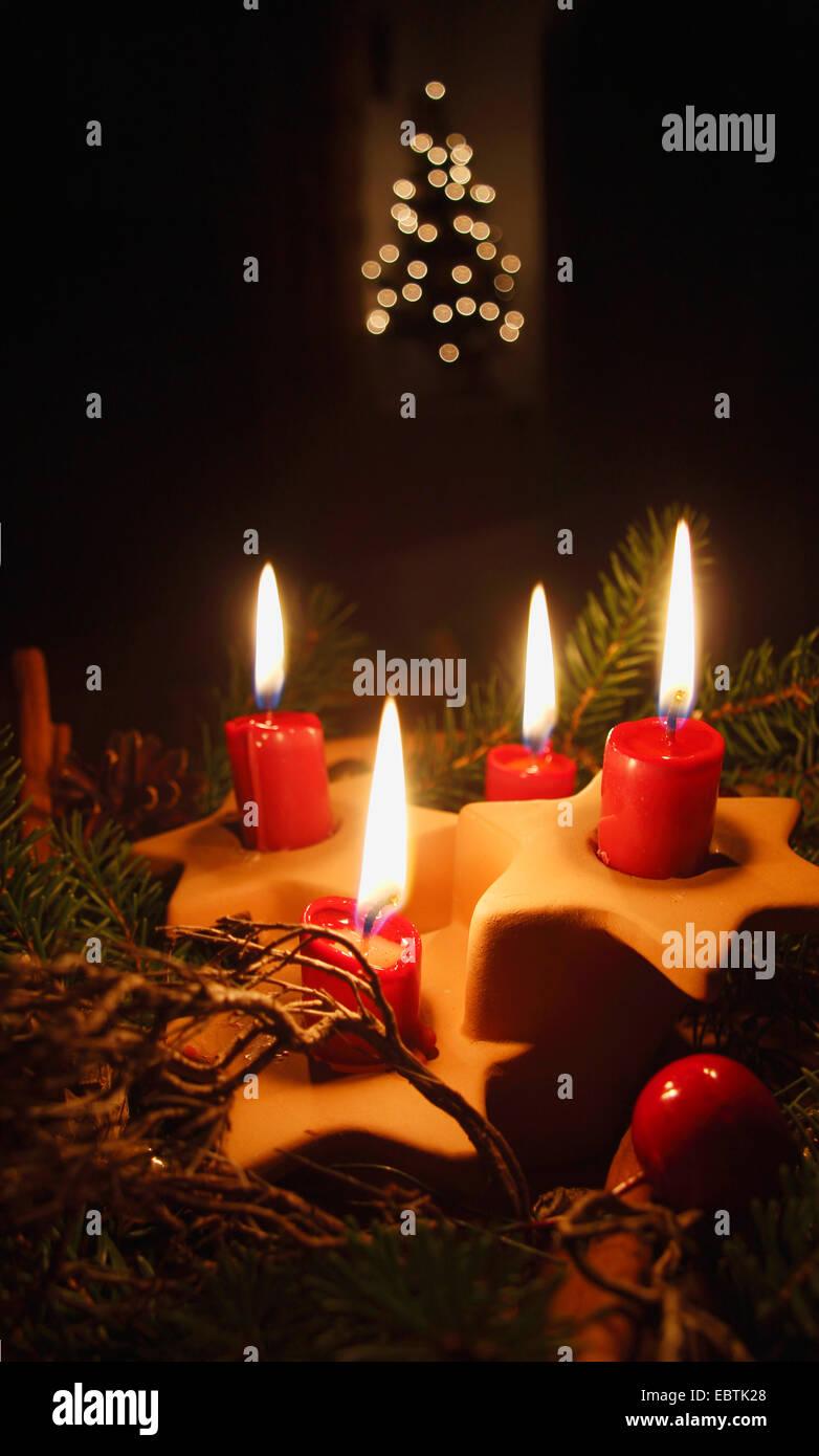 vier rote Kerzen Stockfoto
