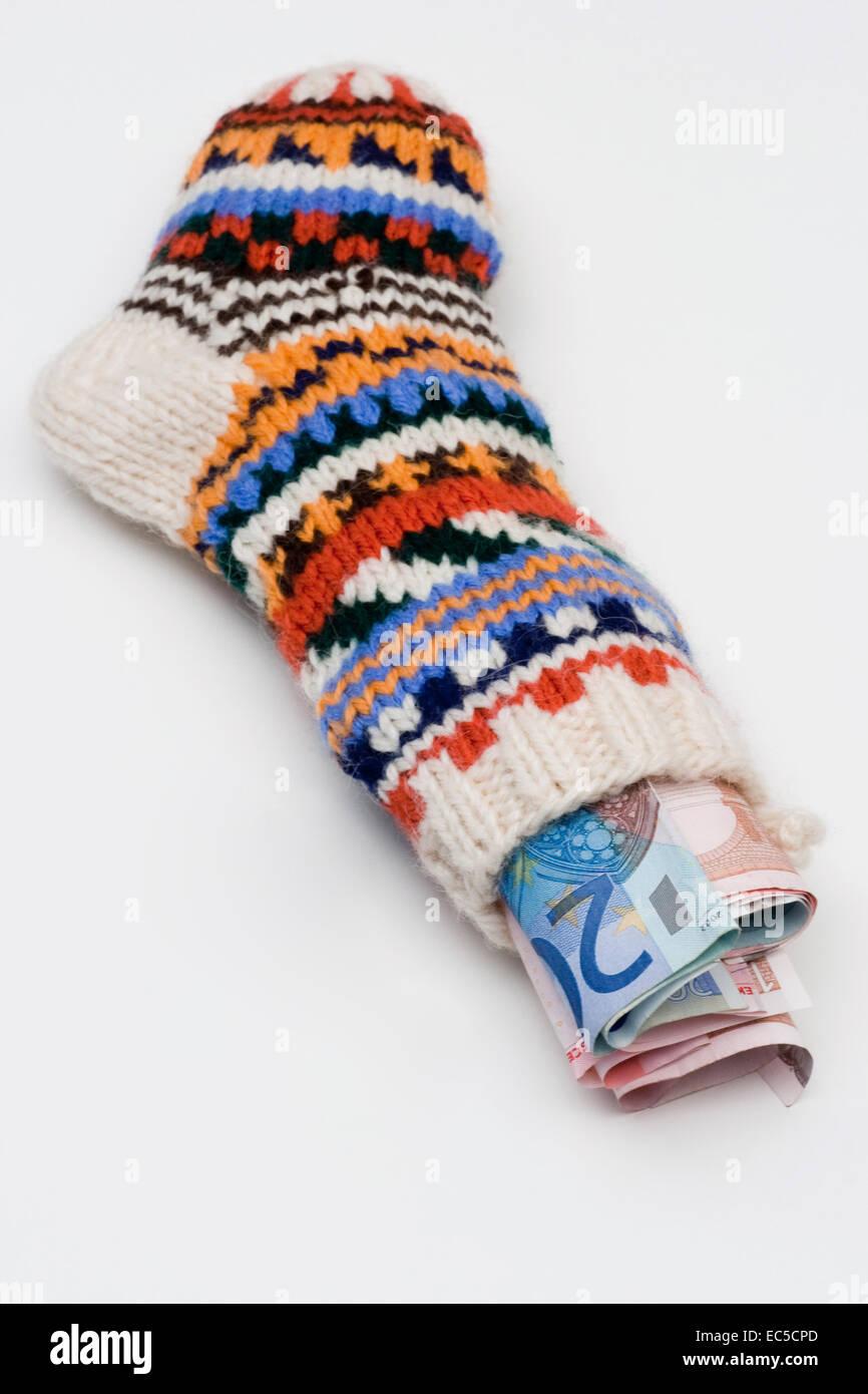 Alternative, Hand gestrickte Geld Socke Stockbild