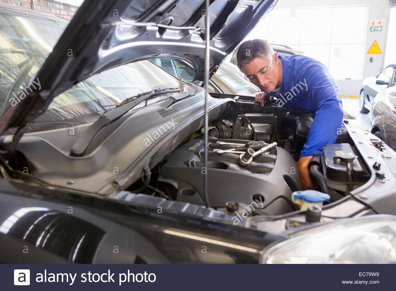 Mechanic Working On Car Stockfotos & Mechanic Working On Car Bilder ...