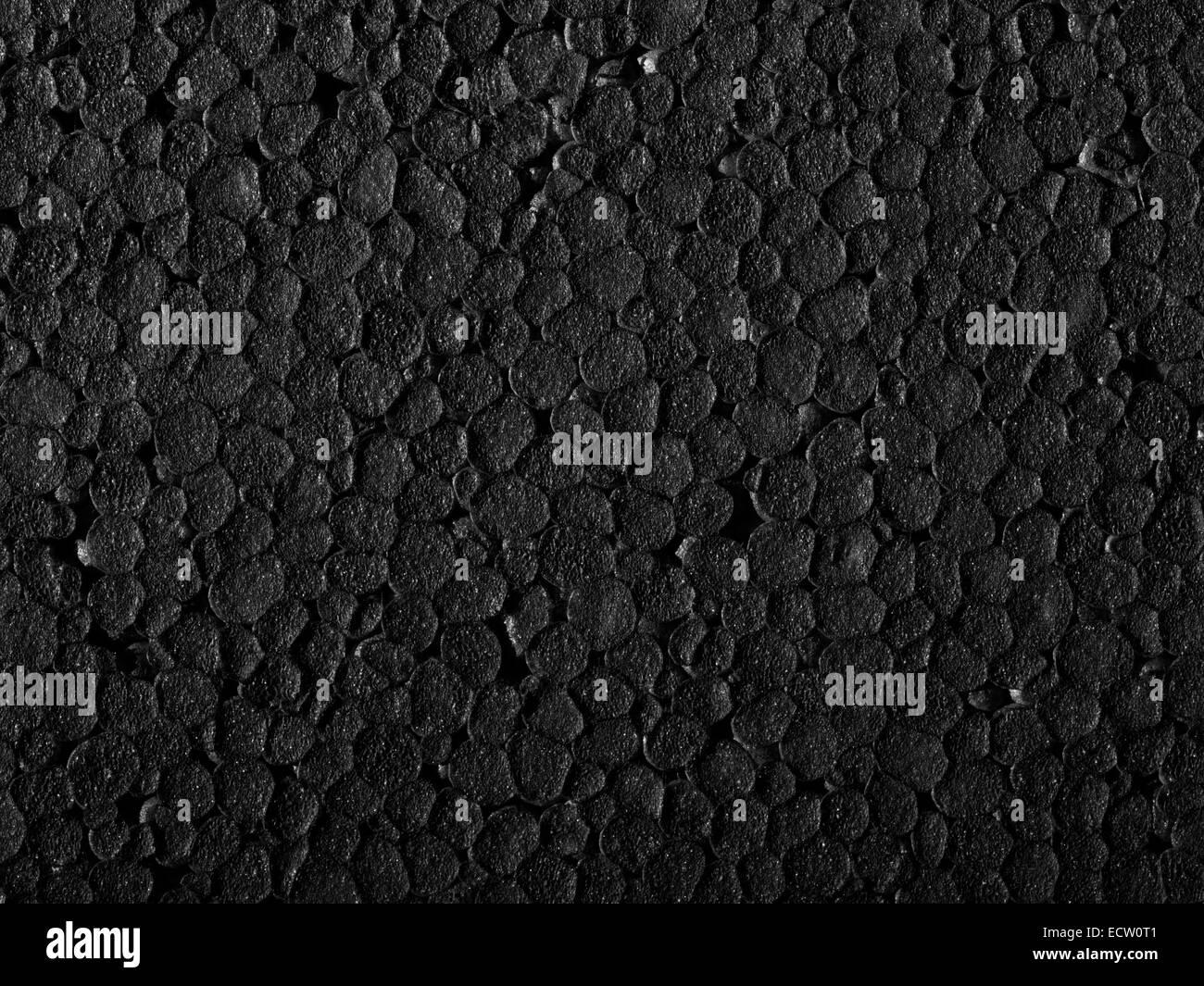 Full-Frame-Nahaufnahme einer schwarzen Polystyrol-Oberfläche Stockbild