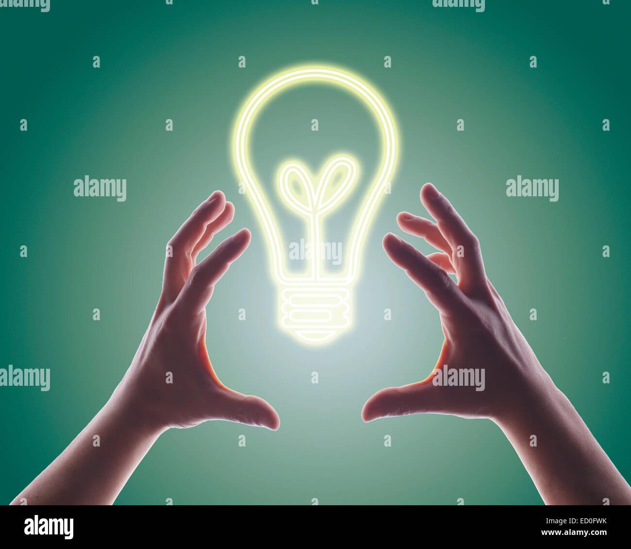 Person die Hände für Digital erzeugte Bild der Glühbirne zu erreichen Stockfoto