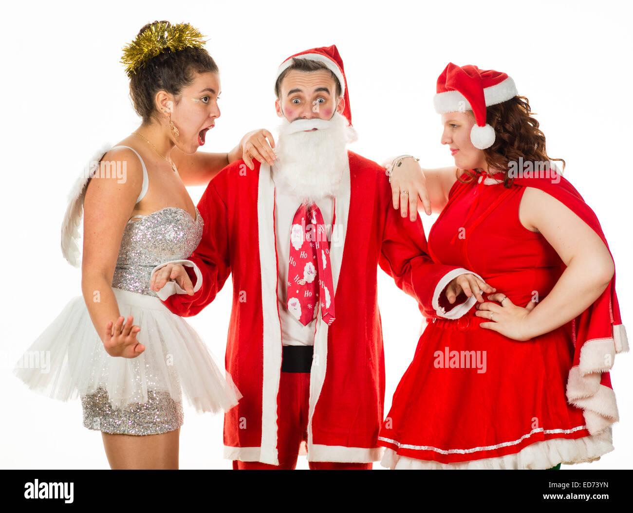 Engel Fee, Santa Claus und Frau Claus: drei junge Menschen, zwei ...