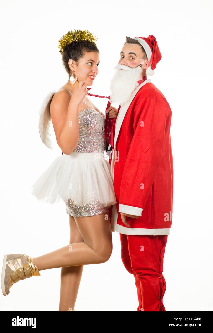 Weihnachtsengel mit Santa Claus zu flirten: zwei Jugendliche junge ...