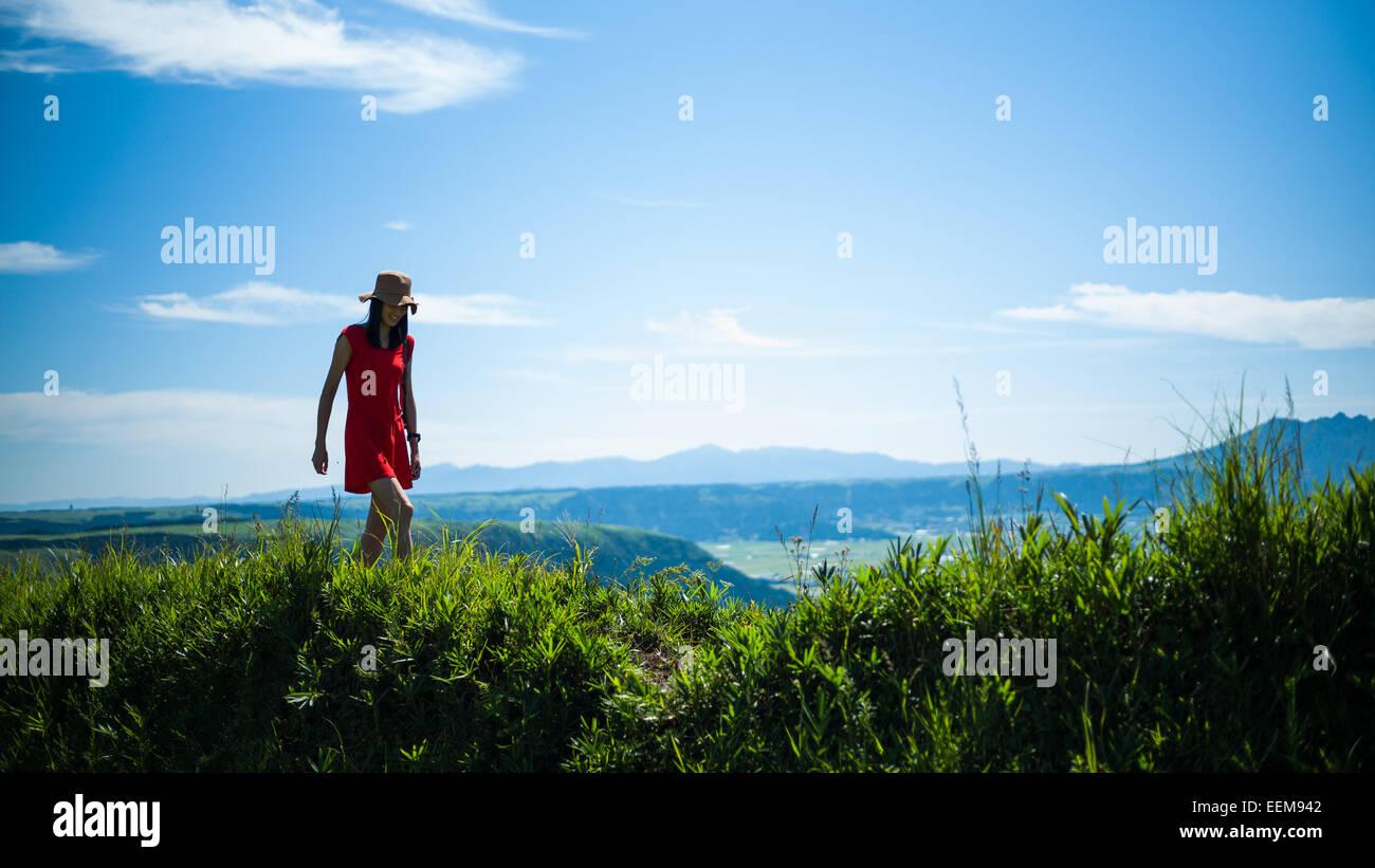 Frau in Bergen Stockbild