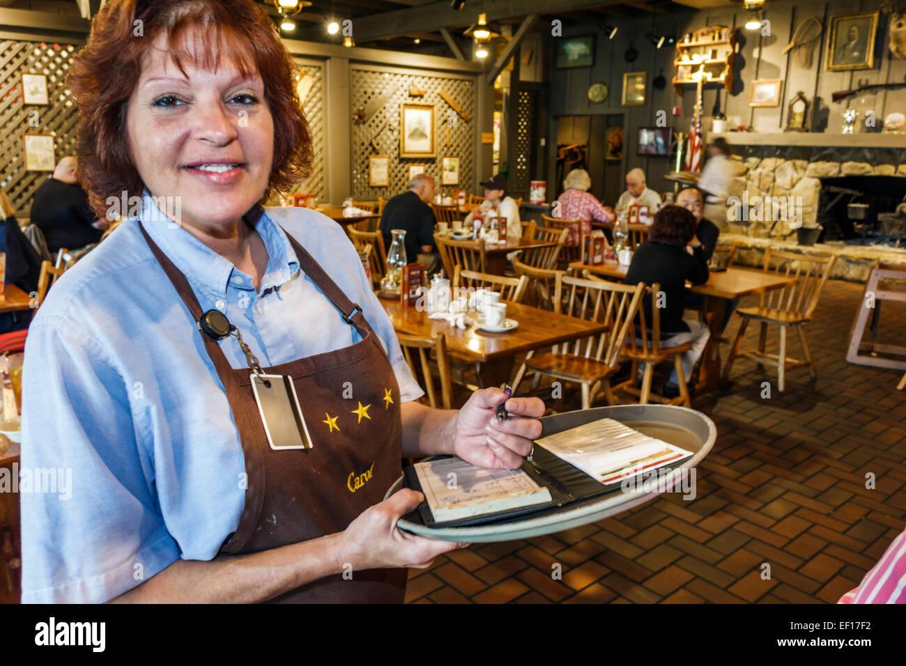Vero Beach Florida Cracker Barrel Country Store Restaurant Frau Kellnerin bestellen Job arbeiten Mitarbeiter Stockbild