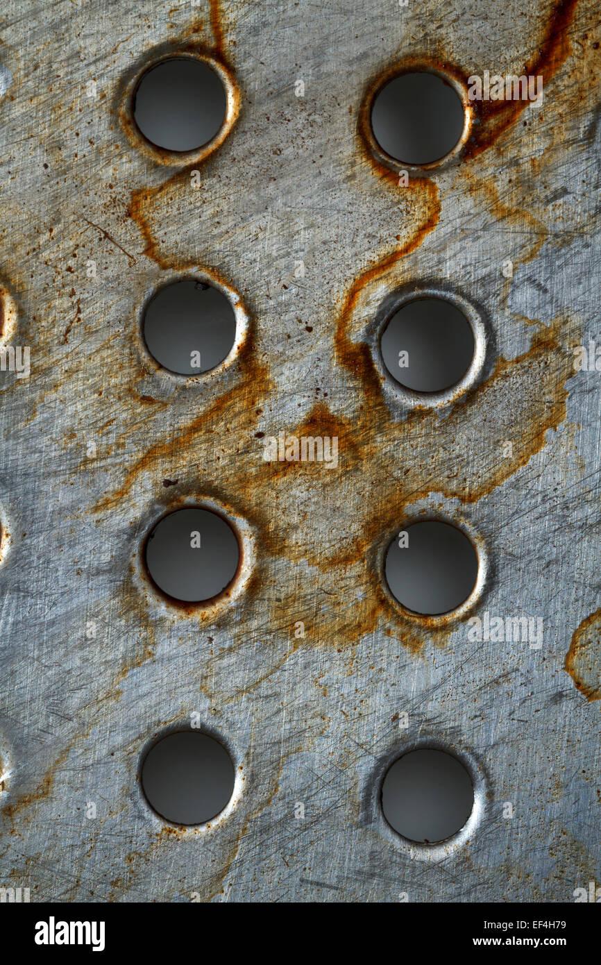 Metall Textur mit Löchern, abstrakten Hintergrund Stockbild