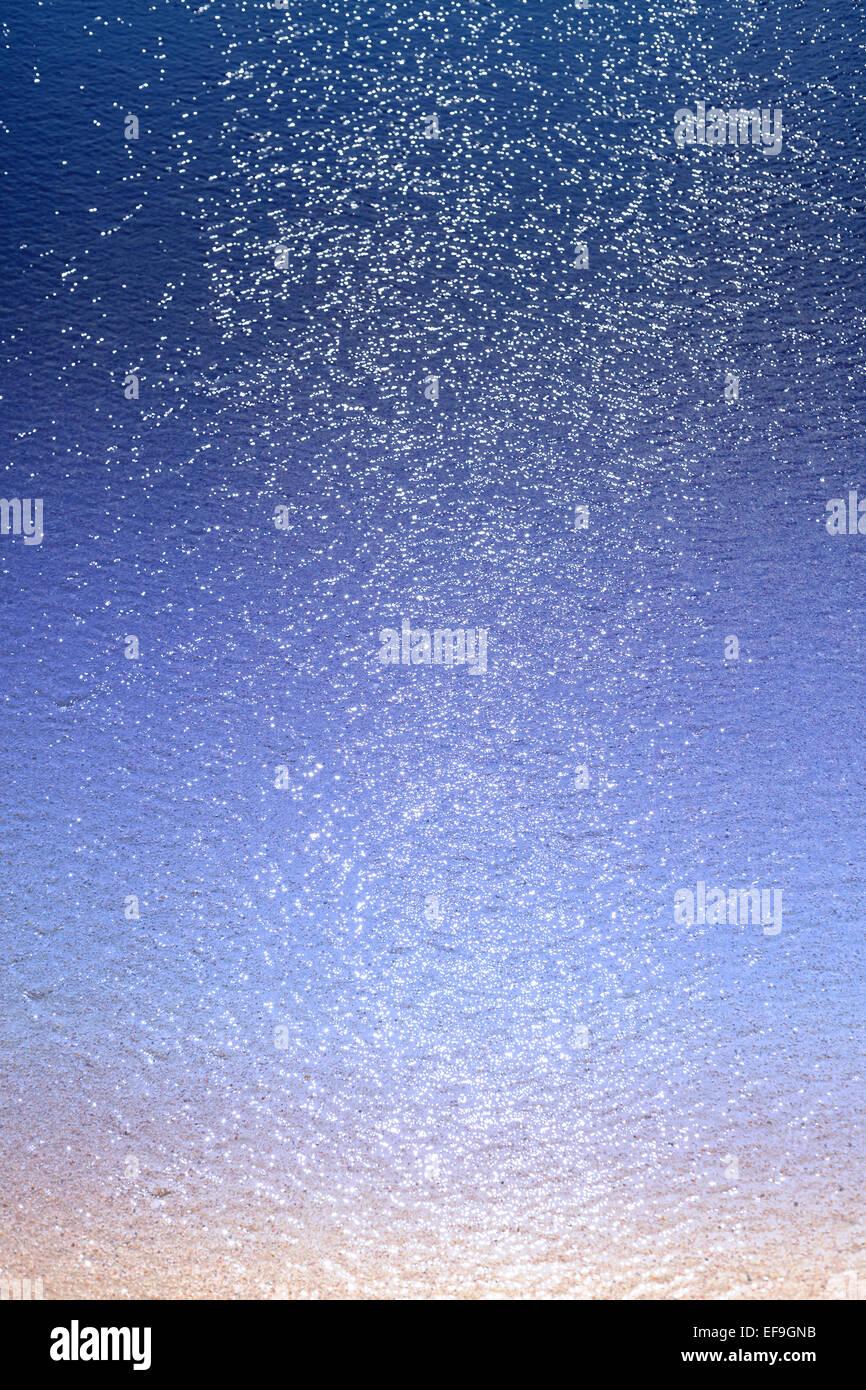 Verschwommene Meer mit Glitzer und Bokeh, abstrakten Hintergrund. Stockbild