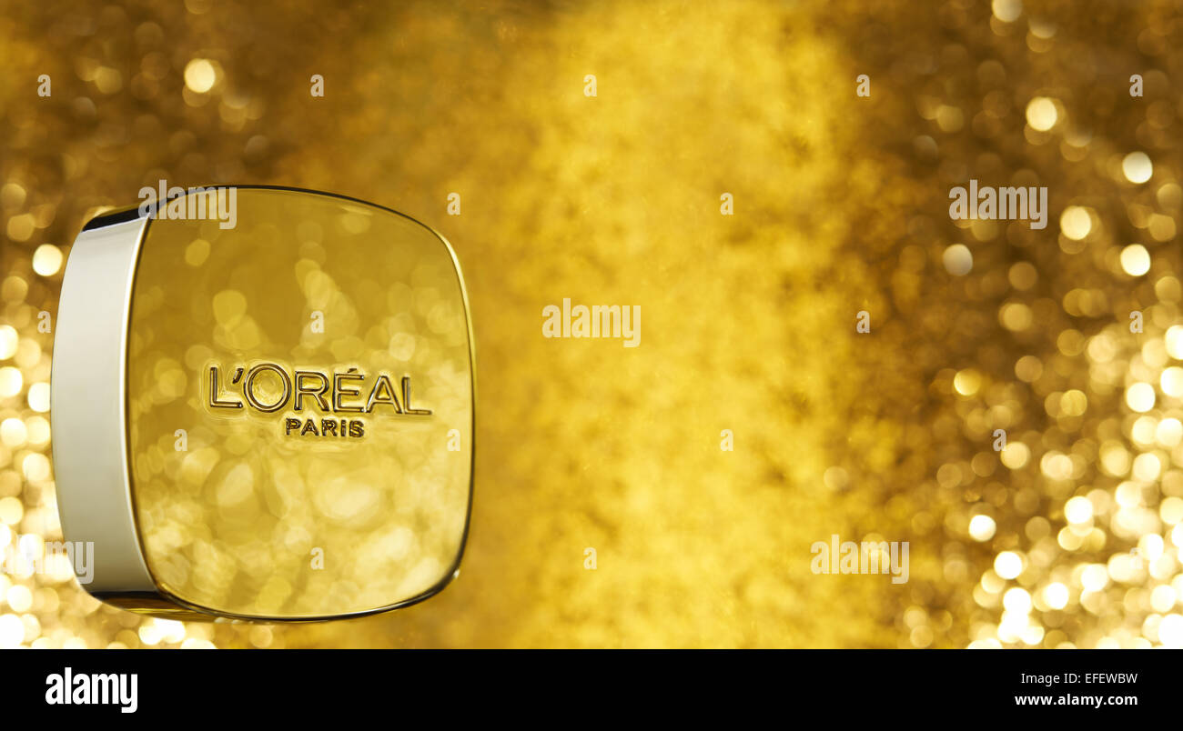 L ' Oreal Paris Produktbild mit gold-glitter Stockbild