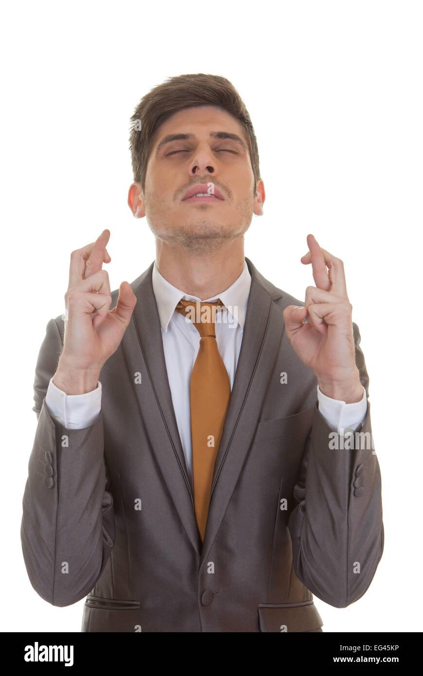 29398a583ae5 Business Mann Daumen drücken geschlossenen Augen in Hoffnung und Optimismus  Stockbild