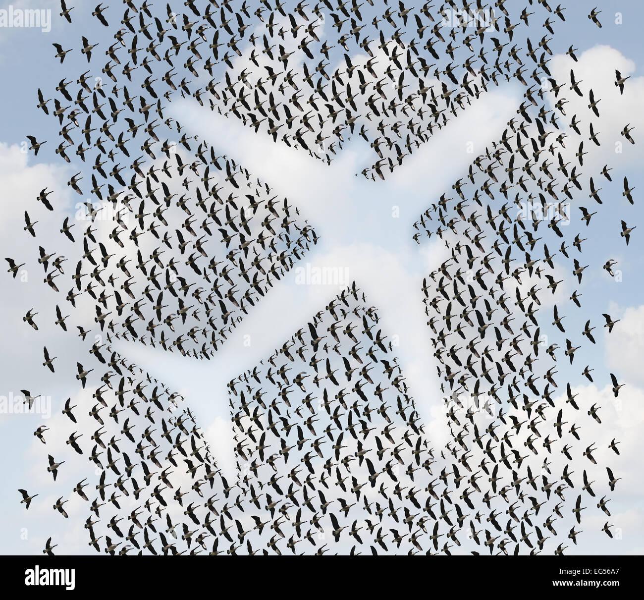 Flugreisen Konzept als eine Herde von fliegenden Vögel oder Gänse in der Form eines Passagierflugzeuges Stockbild