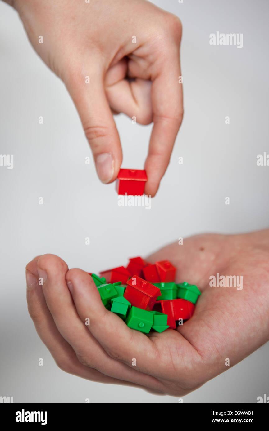 Wählen ein Monopol-Haus. Stockbild