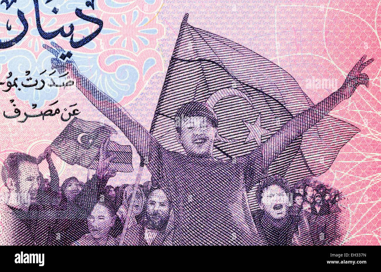 Anti-Gaddafi Demonstranten von 1 Dinar Banknote, Libyen, 2013 Stockbild