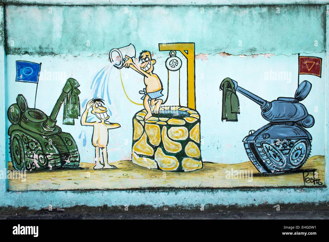 Kuba Santa Clara Reihe von politischen extremen anti-USA North American Cartoon cartoons Wandbilder Wände Soldaten Stockbild