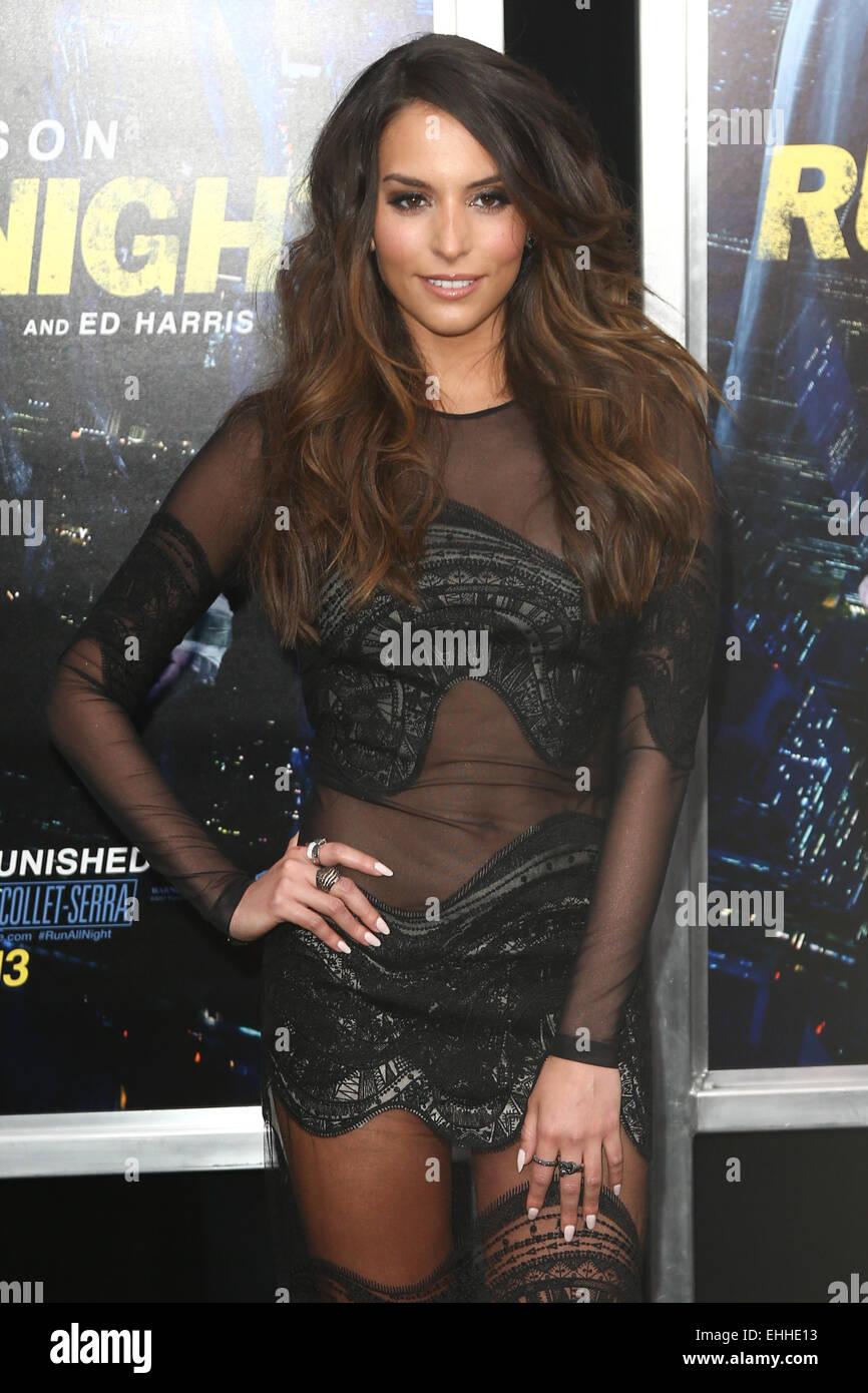 """NEW YORK-MAR-9: Schauspielerin Genesis Rodriguez besucht die Premiere von """"Laufen alle Nacht"""" bei AMC Stockbild"""
