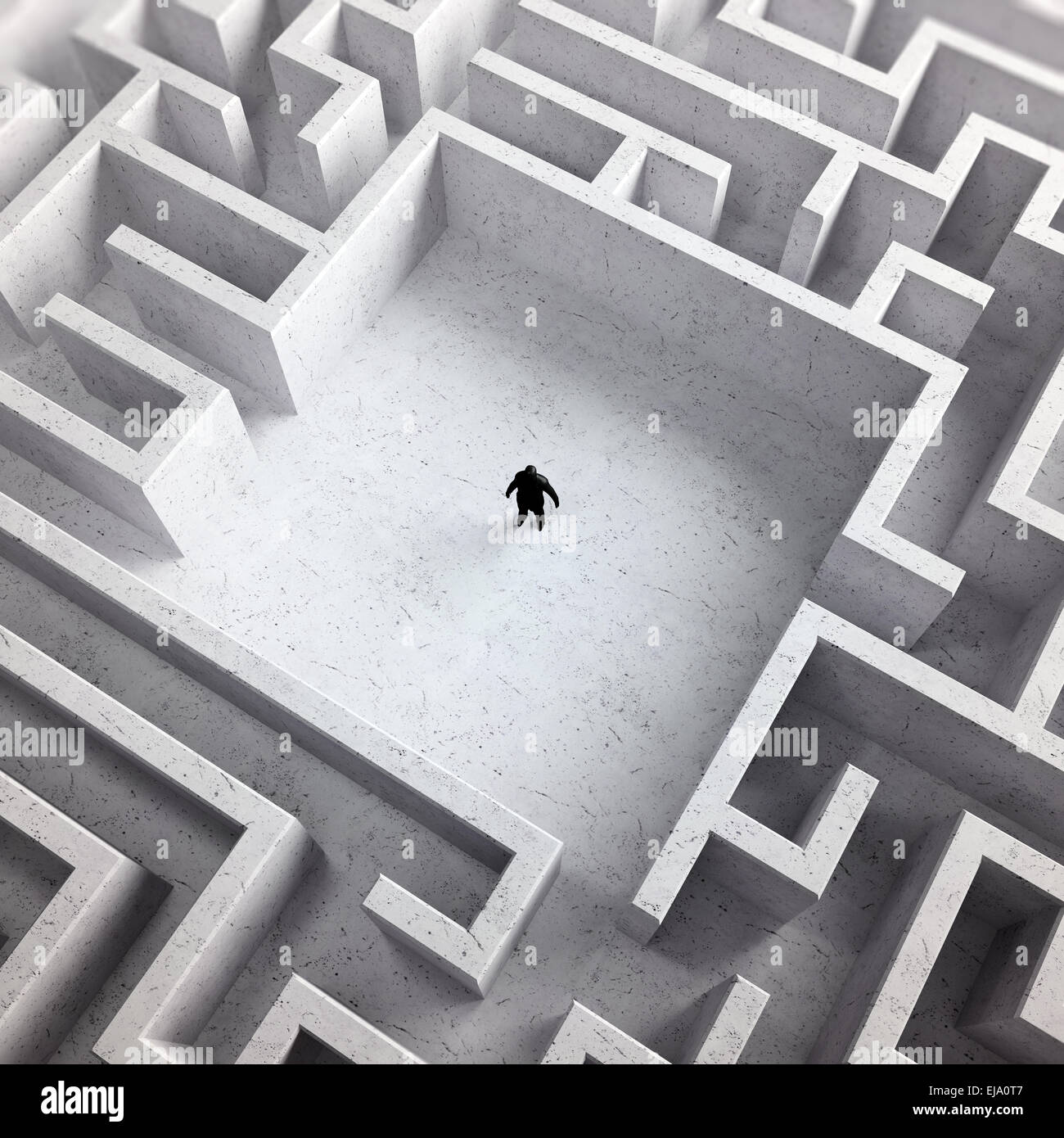 Kleiner Mann im Inneren ein endloses Labyrinth Stockbild