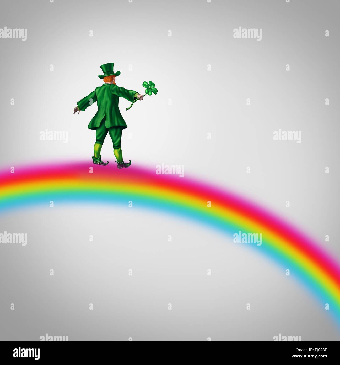 Kobold Fortune Regenbogen als kleine Figur in einem grünen traditionellen St. Patricks Tag Kostüm hält Stockbild