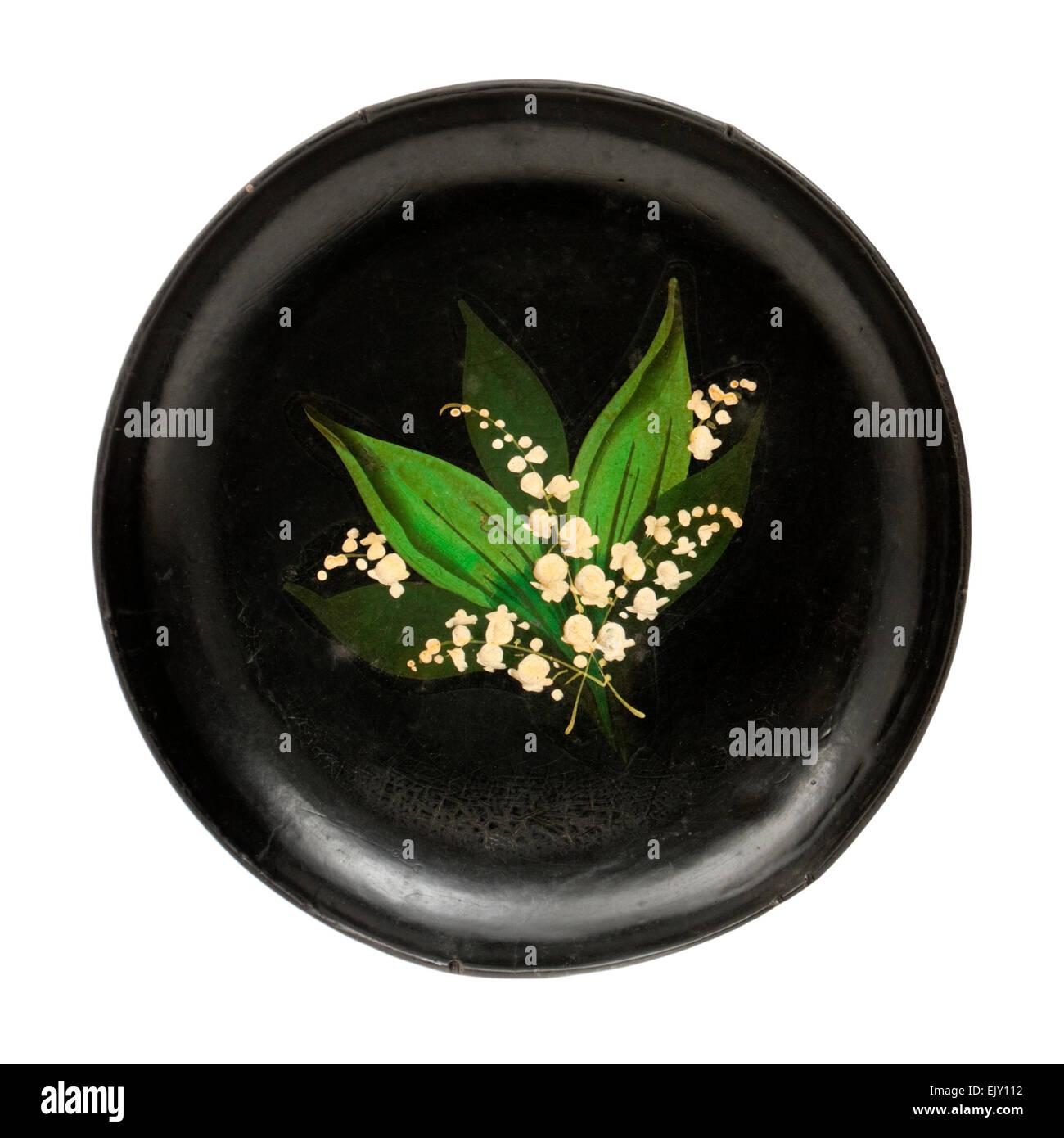 Antikes Papier-Pappmaché-Platte mit Maiglöckchen Blumenschmuck Stockbild