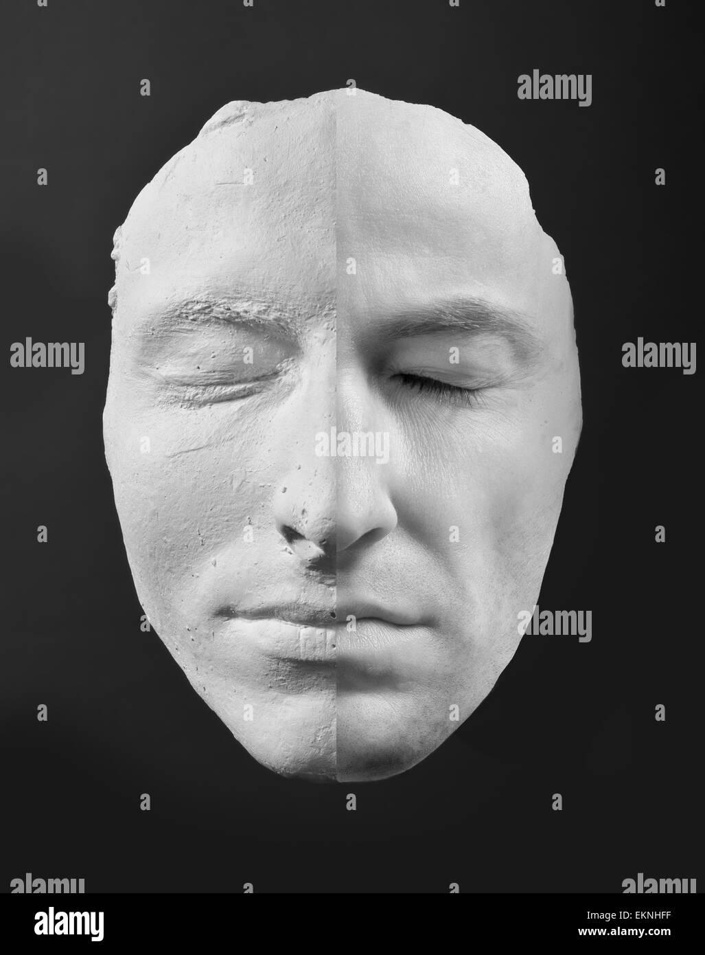 Mann und seine Maske Stockbild