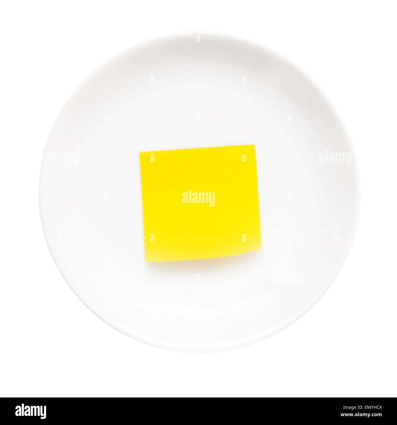 Weißen Teller mit Stick Hinweis darauf isoliert auf weißem Hintergrund. Stockbild