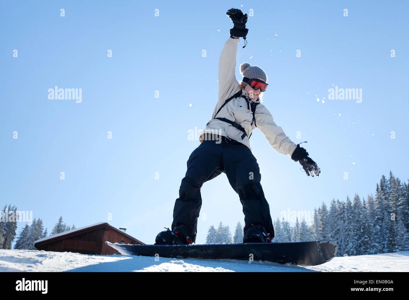 Snowboard, Amateur in der Skischule lernen Stockbild