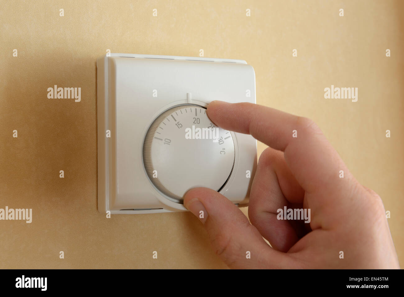 Turning Down Central Heating Thermostat Stockfotos & Turning Down ...