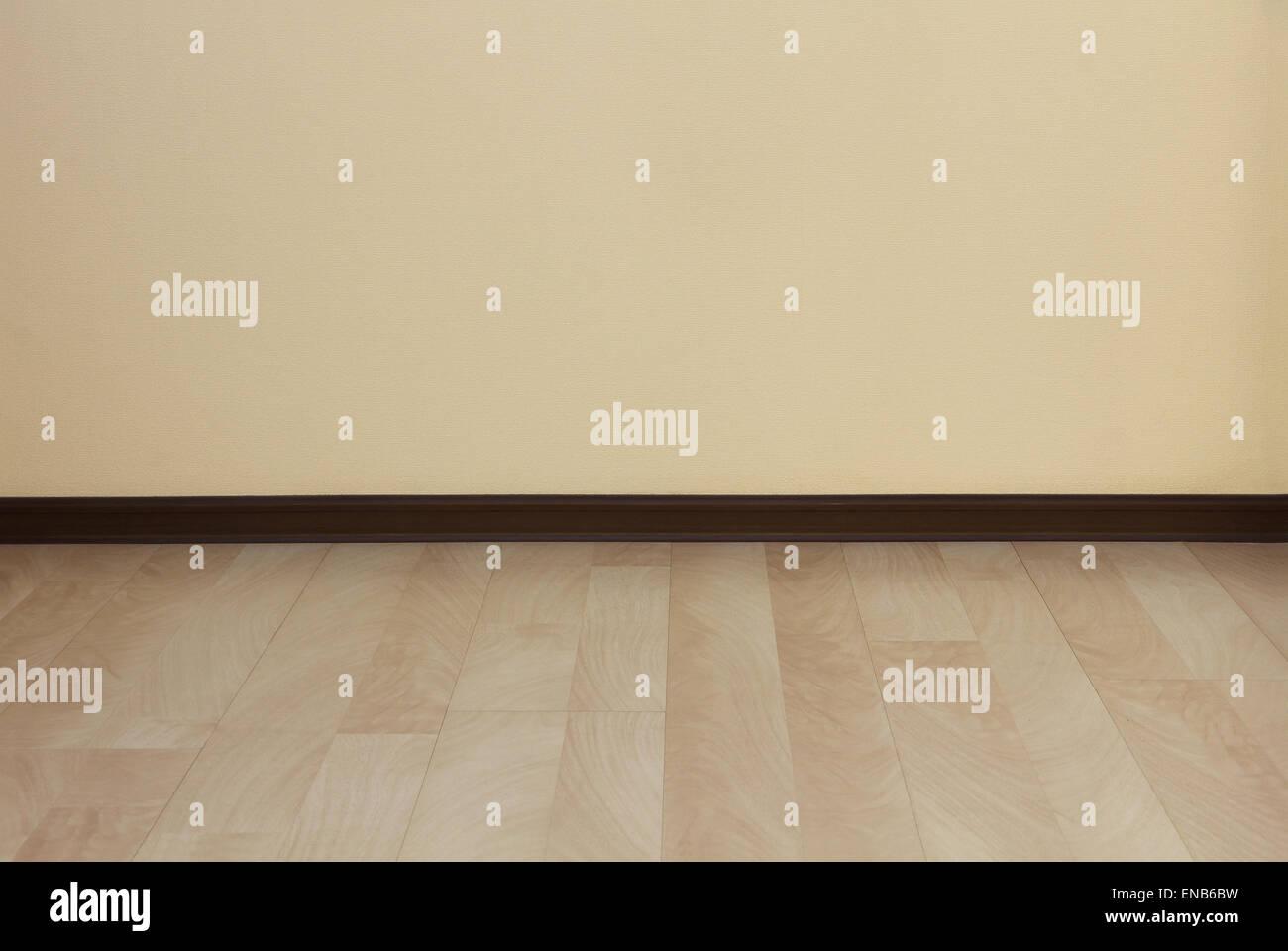 Reinigen Sie Wand Und Laminatboden Als Hintergrund.