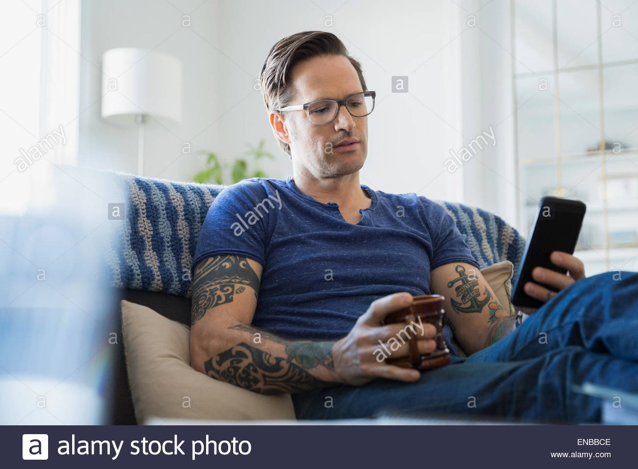 arm with tattoos stockfotos arm with tattoos bilder alamy. Black Bedroom Furniture Sets. Home Design Ideas