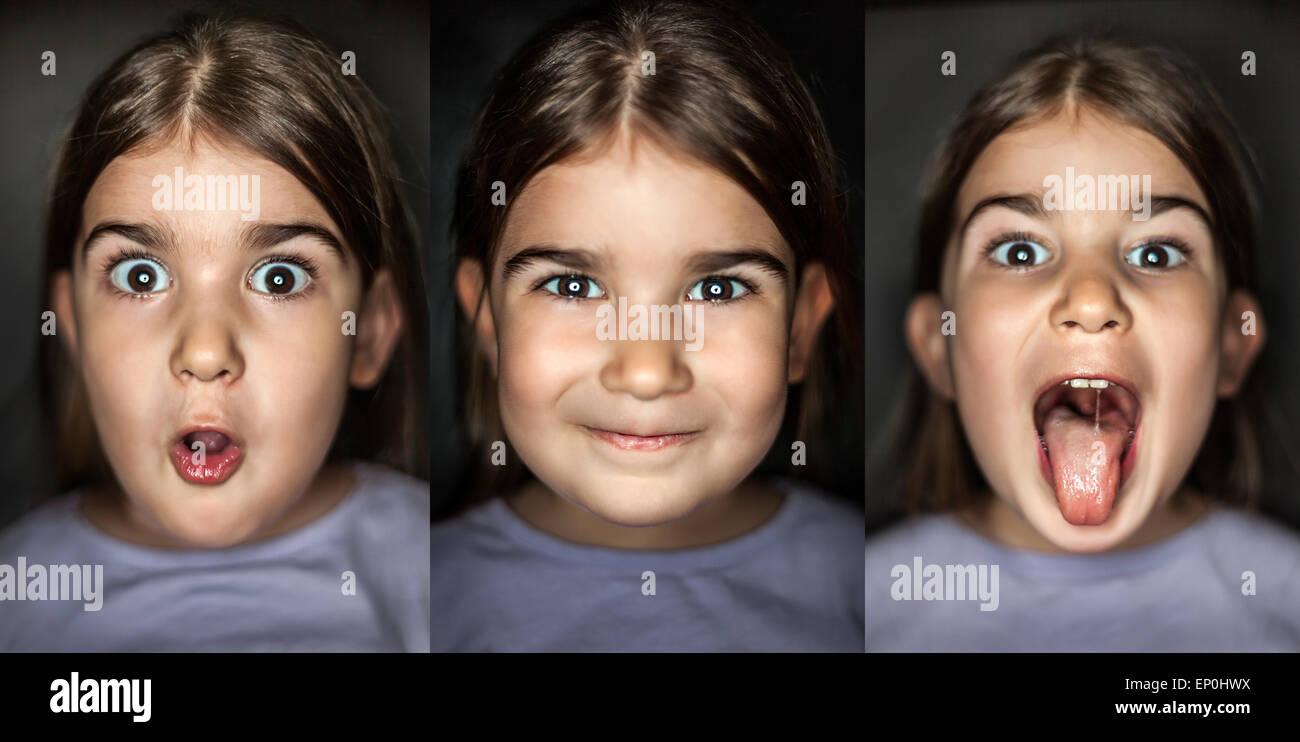 Nettes Mädchen mit unterschiedlichen Gesichtsausdrücken auf schwarzem Hintergrund isoliert amüsant, Stockbild