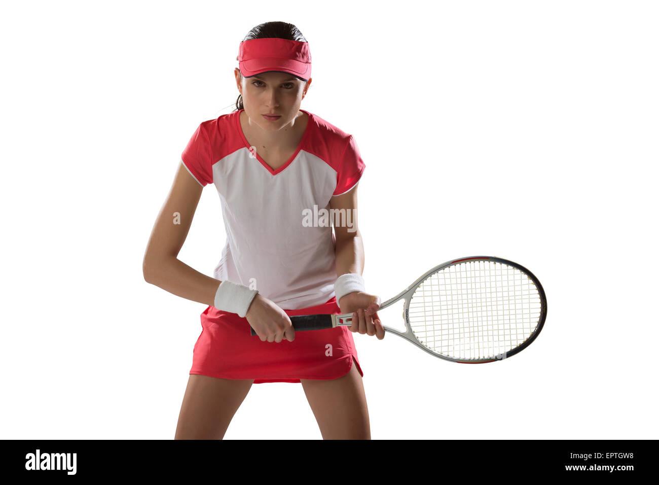 Porträt der jungen Frau, die mit dem Tennisspielen, Studioaufnahme Stockfoto