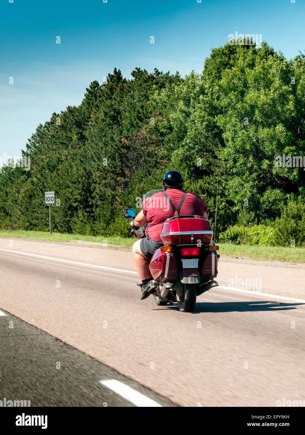 Dicker Mann auf einem Motorrad Stockfoto, Bild: 82964213