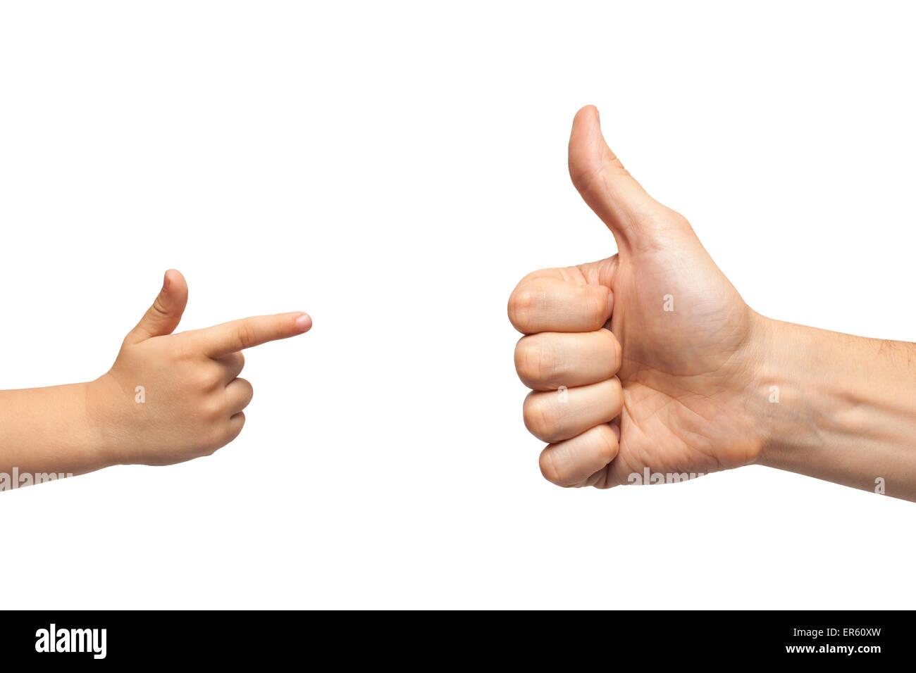 Vater und Sohn Hände wie geben und zeigen, oder Pistole Geste auf weißem Hintergrund. Isoliert Stockbild