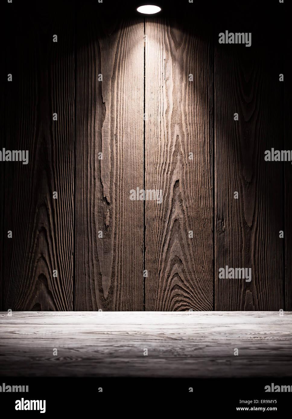 Hintergrundtextur von Holzbrettern mit Beleuchtung von oben Stockbild