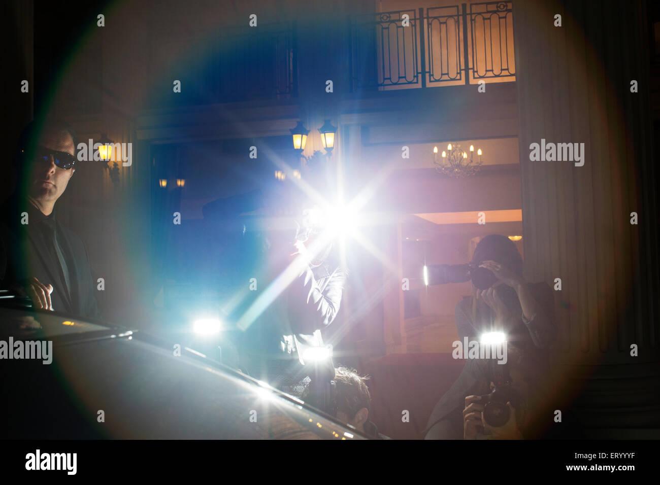 Reflexlicht von Paparazzi fotografiert in Veranstaltung Stockbild
