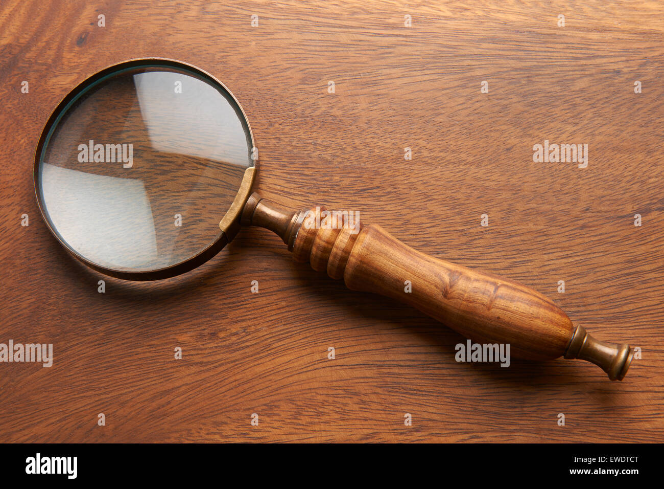 Magnifying Glass On Wooden Background Stockbild