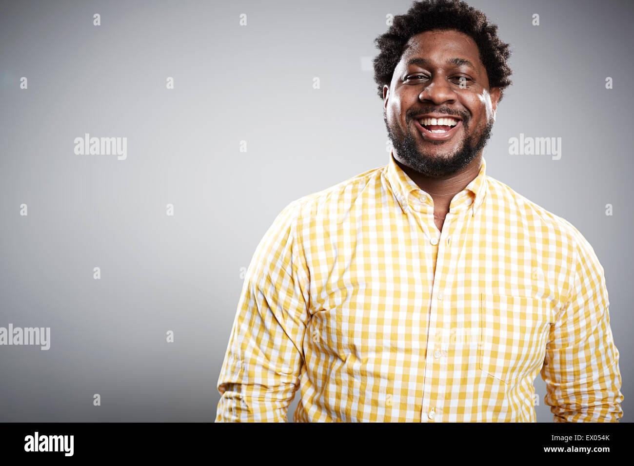 Studio-Porträt der Mitte adult Geschäftsmann lachen Stockbild