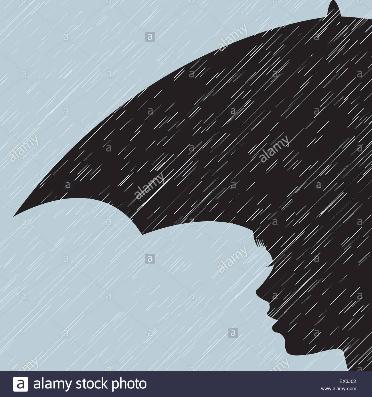 Mädchen mit Regenschirm im Regen Stockbild