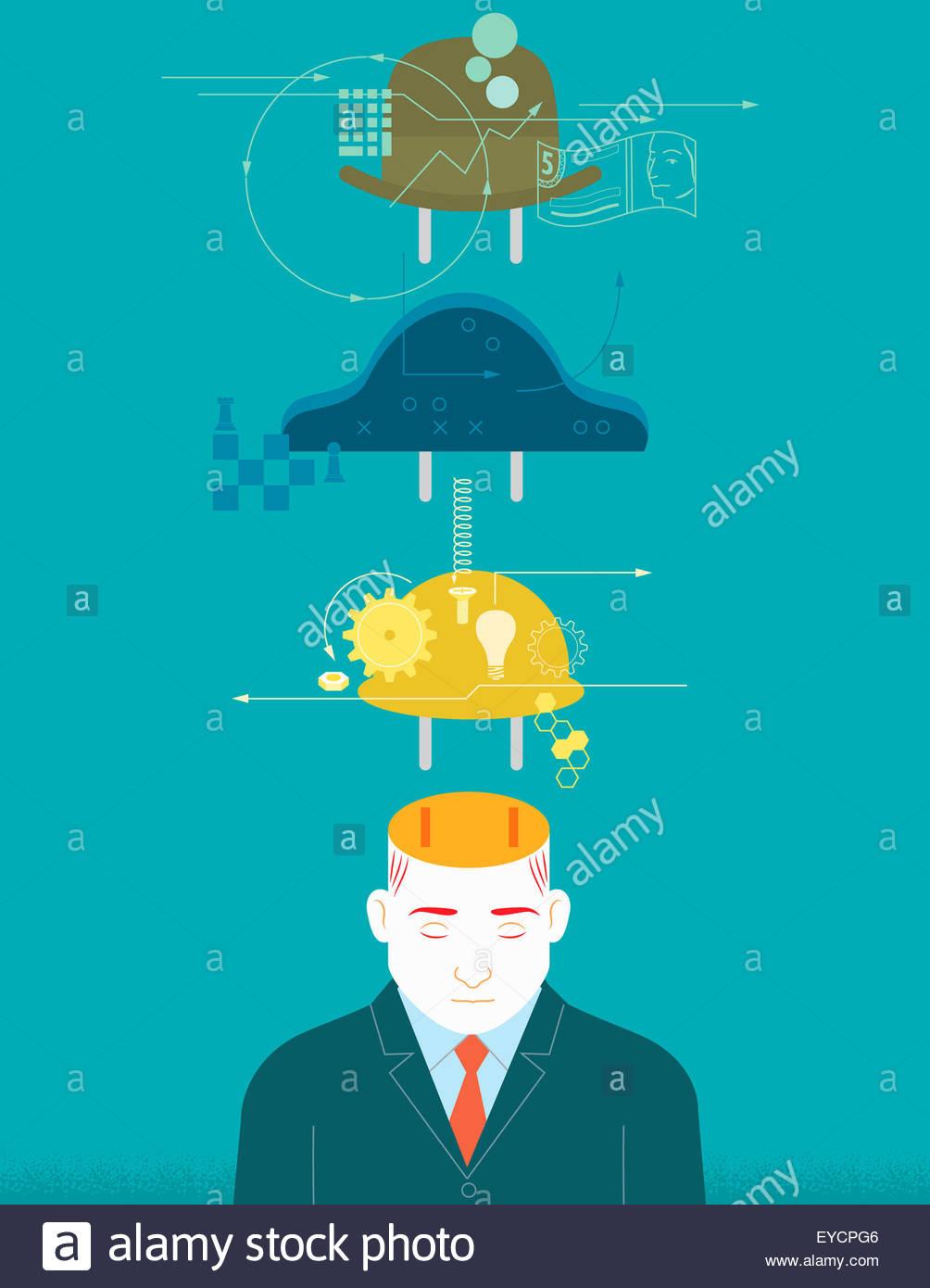 Verschiedene Hüte über Geschäftsmann Stockbild