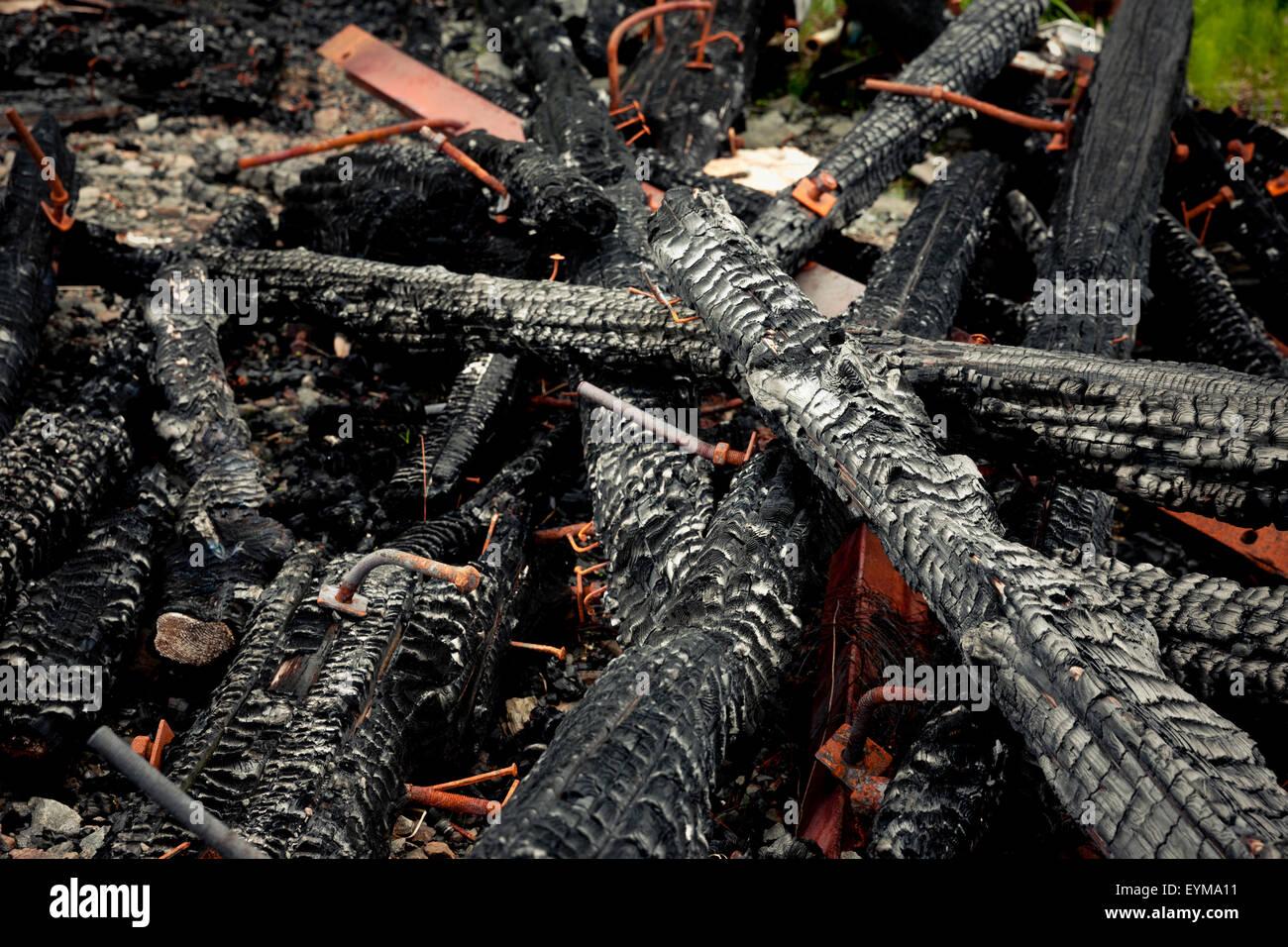 Abgebrannte Holzbalken Stockbild